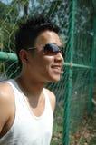 Giovane uomo cinese asiatico freddo Immagini Stock Libere da Diritti