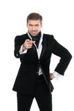 Giovane uomo d'affari alla moda che indica dito allo spettatore Immagine Stock