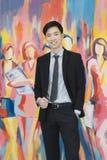 Giovane uomo d'affari asiatico nella condizione nera del vestito immagini stock libere da diritti