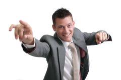 Giovane, uomo d'affari bello che indica in avanti Immagine Stock