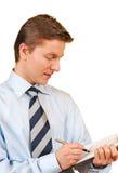 Giovane uomo d'affari che cattura le note Fotografia Stock Libera da Diritti