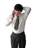 Giovane uomo d'affari che comunica sul telefono Immagini Stock