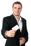 Giovane uomo d'affari che dà è biglietto da visita Fotografia Stock