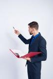 Giovane uomo d'affari che fa una presentazione fotografia stock