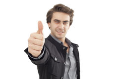 Giovane uomo d'affari che mostra segno GIUSTO con il suo pollice su Fotografia Stock Libera da Diritti