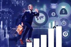 Giovane uomo d'affari che salta sopra i punti del grafico o del grafico Immagine Stock