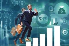 Giovane uomo d'affari che salta sopra i punti del grafico o del grafico Immagine Stock Libera da Diritti
