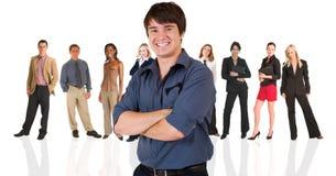 Giovane uomo d'affari che si leva in piedi dentro Fotografia Stock Libera da Diritti