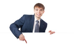 Giovane uomo d'affari che tiene scheda in bianco bianca Immagine Stock Libera da Diritti