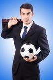 Giovane uomo d'affari con calcio sul bianco Fotografia Stock Libera da Diritti