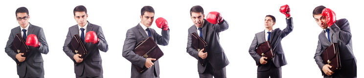 Giovane uomo d'affari con i guanti della scatola e della cartella isolati sul whi Fotografie Stock