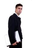 Giovane uomo d'affari con il computer portatile fotografia stock
