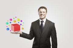 Giovane uomo d'affari con le caselle colorate Immagine Stock