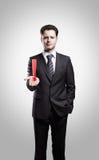 Giovane uomo d'affari con un contrassegno di esclamazione Fotografia Stock