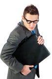 Giovane uomo d'affari con un portafoglio fotografie stock libere da diritti