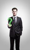 Giovane uomo d'affari con un punto interrogativo Immagine Stock