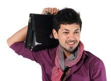Giovane uomo d'affari con una cartella sul bianco Immagini Stock