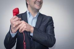Giovane uomo d'affari felice con il telefono Immagine Stock