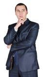 Giovane uomo d'affari in un vestito con una penna Fotografia Stock