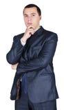Giovane uomo d'affari in un vestito con una penna Fotografie Stock
