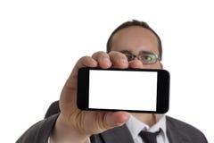 Giovane uomo d'affari in vestito con il cellulare Immagini Stock Libere da Diritti