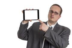 Giovane uomo d'affari in vestito con il computer della compressa Immagini Stock