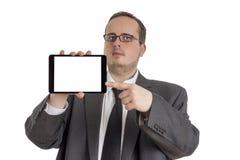 Giovane uomo d'affari in vestito con il computer della compressa Immagine Stock