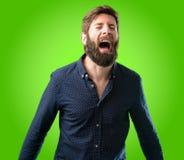 Giovane uomo dei pantaloni a vita bassa con la barba e la camicia Immagine Stock Libera da Diritti