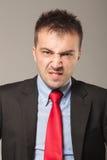 Giovane uomo di affari che fa un fronte di disapprovazione Fotografie Stock