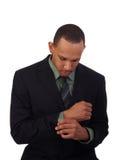 Giovane uomo di colore in vestito di affari che osserva giù Immagini Stock Libere da Diritti