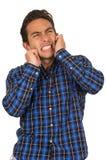 Giovane uomo disperato bello che porta un plaid blu Fotografia Stock