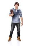 Giovane uomo felice dell'allievo con il taccuino Fotografie Stock Libere da Diritti