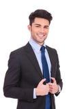 Giovane uomo felice di affari che tiene il suo collare Fotografia Stock Libera da Diritti