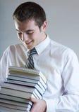 Giovane uomo o allievo sorridente felice di affari con i libri Fotografia Stock