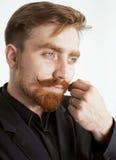 Giovane uomo rosso dei capelli con la barba ed i baffi dentro Immagini Stock Libere da Diritti