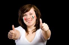 Giovane ventilatore italiano femminile della squadra isolato sul nero Fotografia Stock