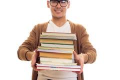 Giovane in vetri con i libri Immagine Stock