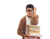 Giovane in vetri con i libri Immagini Stock Libere da Diritti