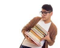 Giovane in vetri con i libri Fotografie Stock