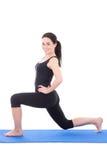 Giovani allungamento ed esercizio attraenti della donna isolati su bianco Fotografie Stock
