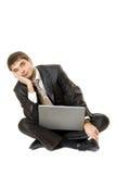 Giovani con il suo computer portatile Fotografie Stock