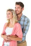 Giovani coppie attraenti che abbracciano e che sorridono Fotografie Stock