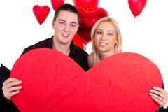 Giovani coppie attraenti che sorridono insieme Immagini Stock