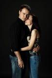 Giovani coppie belle che posano nello studio Fotografie Stock