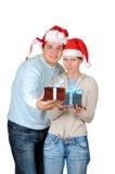 Giovani coppie in cappelli della Santa Immagine Stock