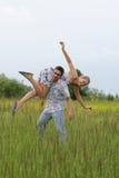 Giovani coppie che hanno divertimento Fotografie Stock Libere da Diritti