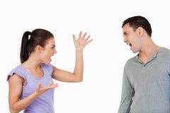 Giovani coppie che hanno una lotta Immagine Stock Libera da Diritti
