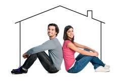 Giovani coppie che sognano nuova casa Immagini Stock Libere da Diritti