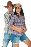 Giovani coppie con i cappelli del cowboy fotografia stock libera da diritti