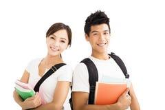 giovani coppie degli studenti con i libri Fotografia Stock Libera da Diritti